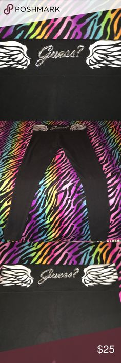 Guess rhinestone leggings Guess rhinestone logo wit silver wings around fold over waistband. Black stretch material and excellent condition. Guess Pants Leggings