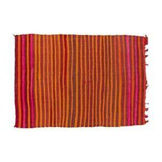Eggplant purple, bright pink and awesome fire orange stripes make up this vintage Moroccan kilim rug. It's super soft wool that is quite gentle to the touch.
