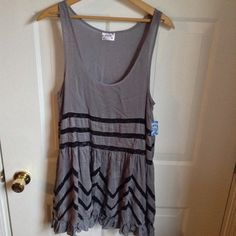⭐️NWT⭐️ FP Lace Voile Trapeze Slip A Free People classic staple piece! Beautiful grey and black slip. Black Lace zig zag detailing on charcoal polka dot fabric. A must-have layering piece!! Free People Dresses Mini