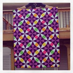 Sewlio: Kaleidoscope Quilt | Wow - the colors she used are wonderful!  For a pattern, she used the QAL at Don't Call Me Betsy (http://www.dontcallmebetsy.com/2011/06/kaleidoscope-qal-start-your-rotary.html)