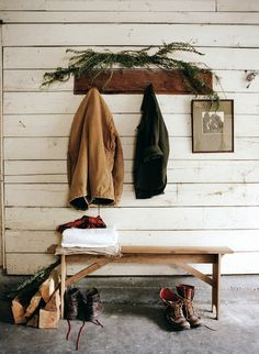 Entryway: Perfect rustic entryway featuring a wooden bench and rough cut mantel shelf with coat hangers.