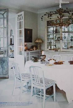 Swedish style...would love the french doors separating kitchen/dining from entry!