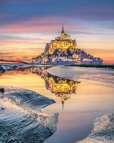 Get a in airbnb for your first holiday. Mont Saint Michel France, Reflection Photography, Beauty Photography, World Pictures, What A Wonderful World, France Travel, Amazing Destinations, Wonders Of The World, Places To Travel
