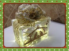ILLUMINATION CREATION GOLD NATIVITY WITH MERRY CHRISTMAS, SILVER/GOLD RIBBON EMBELLISHMENT AND WARM LED BATTERY LIGHTS; LASER ETCHED BY LAVENE & CO.