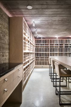 Contemporary wine room which holds over 900 bottles. This wine cellar sits on the lower level of 2009 Cueva de Oro and features a dramatic staircase that descends from the kitchen.