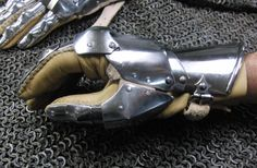 early gothic fingered gauntlets made after an effigy about 1460. Detail thump-plates and buckle.