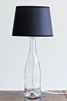 Create your own Maison Martin Margiela inspired bottle lamp! I made mine for less than 4 euros! Very easy and fast DIY on the blog!