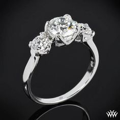 "The ultimate triple threat, this ""W-Prong"" 3 Stone Engagement Ring has it all. The smooth lines flow seamlessly upward to create a trio of W-prong baskets that will display your diamonds to their fullest potential."