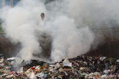 Rubbish is burnt in the sreet, Hangzhou Bay Economic Development Zone.  © Qiu Bo / Greenpeace