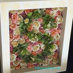 To die for large shadowbox displaying a preserved bridal bouquet with a monogram of greenery We want to create a lovely keepsake for you! #keepsakefloral #floralpreservation #wedding