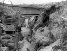 "WW1: One of the most publicized photos of WW1 shows a British trench during a lull. Note those ""resting"", two of them on the floor of the trench. One rifleman remains on guard in case the enemy decides on a sudden attack."