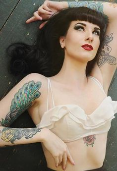 Inked pin up girl - lower sternum tattoo