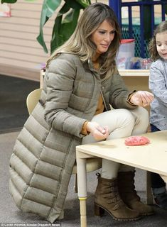Chic: Melania still opted to wear a pair of heels despite the frosty weather, pairing them...