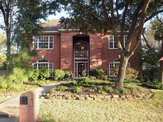 Classic red brick exterior surrounded by great big Kingwood trees.