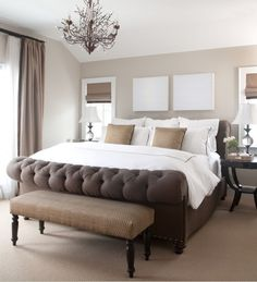 Brown tufted sleigh bed.