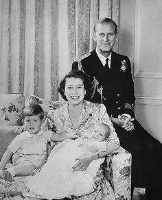 The Duke and Duchess of Edinburgh with son Prince Charles present new daughter Princess Anne from their Clarence House residence in London, January 9, 1951.