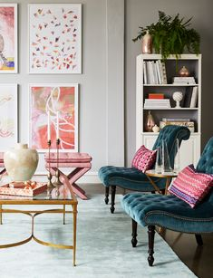 Sophisticated seating area with tufted velvet slipper chairs, gold finish coffee table and patterned pink accent pillows.