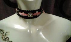 A handmade  black-pinky kinky handmade chocker by StrangeAttachments on Etsy