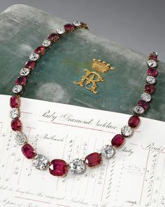 Formerly the property of Mary, Duchess of Roxburghe - A rare and highly important Victorian ruby and diamond necklace, late 19th century. Designed as a rivière of twenty-four cushion-shaped rubies alternating with twenty-four similarly shaped diamonds, mounted in silver and gold, accompanied by the original worksheet stating that four rubies and four diamonds were added to lengthen the original necklace on 24th October 1884.