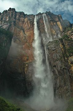 Stand in front of Angel Falls, Venezuela, the tallest waterfall in the world.