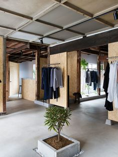 White-painted walls and plywood panels contrast with the existing wooden interior of this vintage clothing store in Saitama city, which was recently renovated by local designer Manabu Okano Clothing Store Design, Vintage Clothing Stores, Diy Clothing, Retail Store Design, Retail Shop, Retail Concepts, Japanese House, Japanese Taste, Japanese Shop