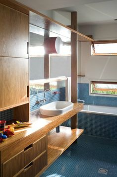 Coop Creative have designed this bathroom that fits perfectly into a beach inspired home.  The retro influence keeps it young and cool.