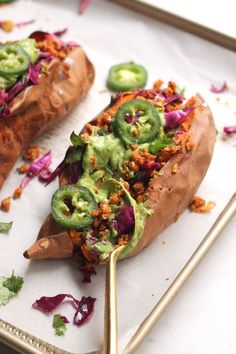 The best vegan taco stuffed sweet potatoes with chickpea pecan filling, cilantro lime cabbage slaw, and avocado crema. The perfect healthy meatless meal for the whole family!