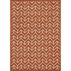 Wool rug with a chevron motif. Hand-tufted in India.    Product: RugConstruction Material: 100% WoolColor: TangerineFeatures: Hand-tuftedNote: Please be aware that actual colors may vary from those shown on your screen. Accent rugs may also not show the entire pattern that the corresponding area rugs have.Cleaning and Care: Clean spills immediately by blotting with a clean sponge or cloth. Vacuum carefully without beater bar. Expect shedding. Professional cleaning recommended. Rug pad ...