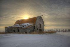 The setting sun over an old barn near Leader Saskatchewan February 17, 2015