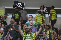 A Rowdies fan waves flags ahead of the first half of the game between Tampa Bay Rowdies and Orlando City B at Al Lang Stadium in St. Petersburg, Fla. on Saturday, March 25, 2017.