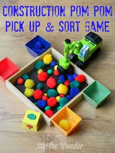 Construction Pom Pom Pick Up & Sort Game -- love the added die to make the activity a game (use the excavator from the Play-Doh set or just use tongs) Montessori, Motor Activities, Preschool Activities, Creative Curriculum Preschool, Cognitive Activities, Preschool Education, Preschool Class, Educational Activities, Construction Theme Preschool