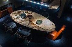 """Lagos Baxter From the splendid collection Baxter here is its majesty """"Lagos"""" the table. Blocks and slabs vary visibly as natural stones. Plan in Special Edition realized in granite Patagonia, available only for this table. http://www.martinelstore.com/en/prod/tables/lagos-baxter.html"""