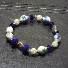 I love the cobalt beads paired with the blue flower stained beads.  Simply beautiful.  See listing at https://www.etsy.com/listing/234655623/beaded-bracelet-blue-beaded-bracelet