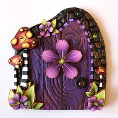 A private entrance for your fairies... Purple Fairy Door Pixie Portal Toadstool Fairy Garden by Claybykim