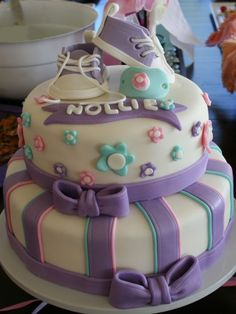 Shower cake I made for my niece! Baby converse shoes and pacifier topper...