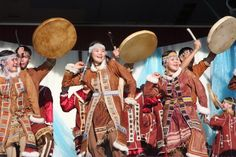 Itelmen dancers: The Itelmen (AKA Kamchadal) are the indigenous people of the Kamchatka Peninsula in Russia.  A hunter-gatherer & fishing society decimated by the Cossack conquest in the 18th century, today their language is virtually extinct. The Itelmen language is distantly related to Chukchi & Koryak; together they form the Chukotko-Kamchatkan language.  Though less than 100 elderly speakers of  the language are left, there are ongoing efforts to revive it.