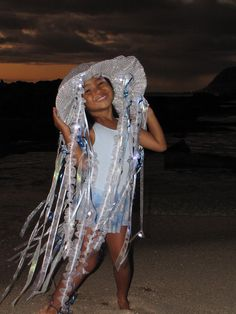 Made with love by mommy!  @2009 Jellyfish Invasion.  Sequined fabric covered hat with curled gift wrap ribbon and fabric ribbon.  LED finger lights will definitely stop traffic and keep your little one safe on the street while she gets her sweets.