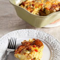 Christmas Breakfast Casserole Recipe Breakfast and Brunch with bread, breakfast sausages, red bell pepper, green bell pepper, onions, garlic, eggs, milk, creole seasoning, kosher salt, colby jack cheese