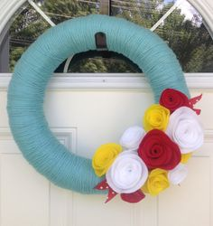 "Turquoise Yarn Wreath with Felt Flowers, Felt Flower Wreath, Summer Wreath, Spring Wreath, Bright Colored Wreath, Front Door Wreath, 18"" by TheVioletteBloom on Etsy https://www.etsy.com/listing/167235941/turquoise-yarn-wreath-with-felt-flowers"