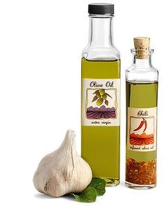 Glass Olive Oil Bottles available in woozy, cylinder and square glass bottle styles with black, gold, red or white plastic screw caps or earthy cork stoppers.