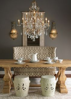 Love the table & dark gray dining room walls with gold