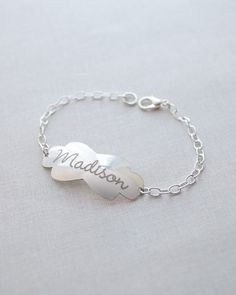 Engraved Name Plate Bracelet by Olive Yew. For the woman who likes a bolder look, the Madison name bracelet features an engraved name plate that is lightly rounded and beautifully curvy.