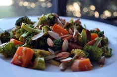 ingredients:   1 sweet potato, chopped into medium sized pieces   1 crown of broccoli, cut into pieces   1 clove garlic, minced   1-2 tsp sambal oelek (asian chili paste)   2 tbsp + 2 tsp olive oil   1 tsp salt   1/4 cup whole raw almonds           directions:   Preheat oven to 400ºF. Place the sweet potatoes in a baking dish, season with 1/2 tsp. salt and 2 tsp. of olive oil. Stir and then roast for 20 minutes. Meanwhile, in mixing bowl mix the rest (2 tbsp.) of the olive oil, salt & the…