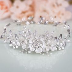 This feminine CHRYSANTHE jewelry item is an extravagant sweet-looking model. Its a fabulous product for classic-looking brides with Cinderella gowns, fairy-tale like makeup and rose updos. Three charming white faux pearl flowers are the center of