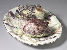 An Important Pair of Chelsea Partridge Tureens and Covers together with their Stand An Important Pair of Chelsea Partridge Tureens and Covers together with their Stand, each partridge modelled seated on a nest, the lower part of the tureen moulded in crisp low relief, with basket weave beneath applied sieved ... Read More