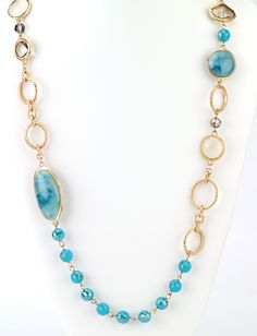 "Faceted beads of turquoise blue colors create a beautiful gold link chain long necklace. 24"" long, with 2"" extender glass/acrylic/gold plated"