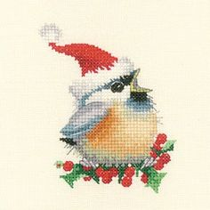 Heritage Crafts Christmas Chick - Cross Stitch Pattern. An adorable little Chickadee dressed in a Santa hat! Designed by Valerie Pfeiffer. Model stitched on 14