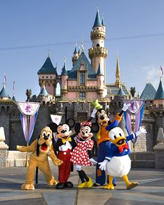 THE FAB 5 -- The classic Disney characters welcome visitors outside Sleeping Beauty Castle at Disneyland in Anaheim, Calif. (L-R) Pluto, Mickey Mouse, Minnie Mouse, Goofy and Donald Duck (Scott Brinegar/Disneyland)