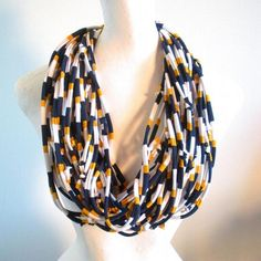 Fall Fashion Navy blue gold white infinity scarf, cowl scarf, team colors, school colors, upcycled clothing, winter asccessories, neck warmer, men's scarf, women's scarf, recycled cotton jersey scarf, repurposed clothing.Your LovelySquid scarf may be worn as an accent accessory or as a fully functioning winter scarf. The more you wrap it around you, the warmer they are. They can be worn alone or in combination with others. The possibilities are endless!All scarves are lightly tied with a ...