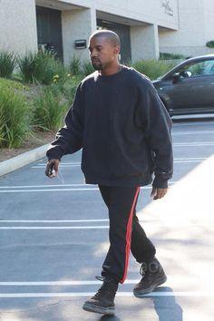 Kanye West wearing Adidas Yeezy Season 4 Calabasas Sweatpants, Champion 50/50 Crewneck Sweatshirt, Ash, Yeezy Brown Military Boots